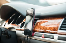 Cell phone on car dashboard